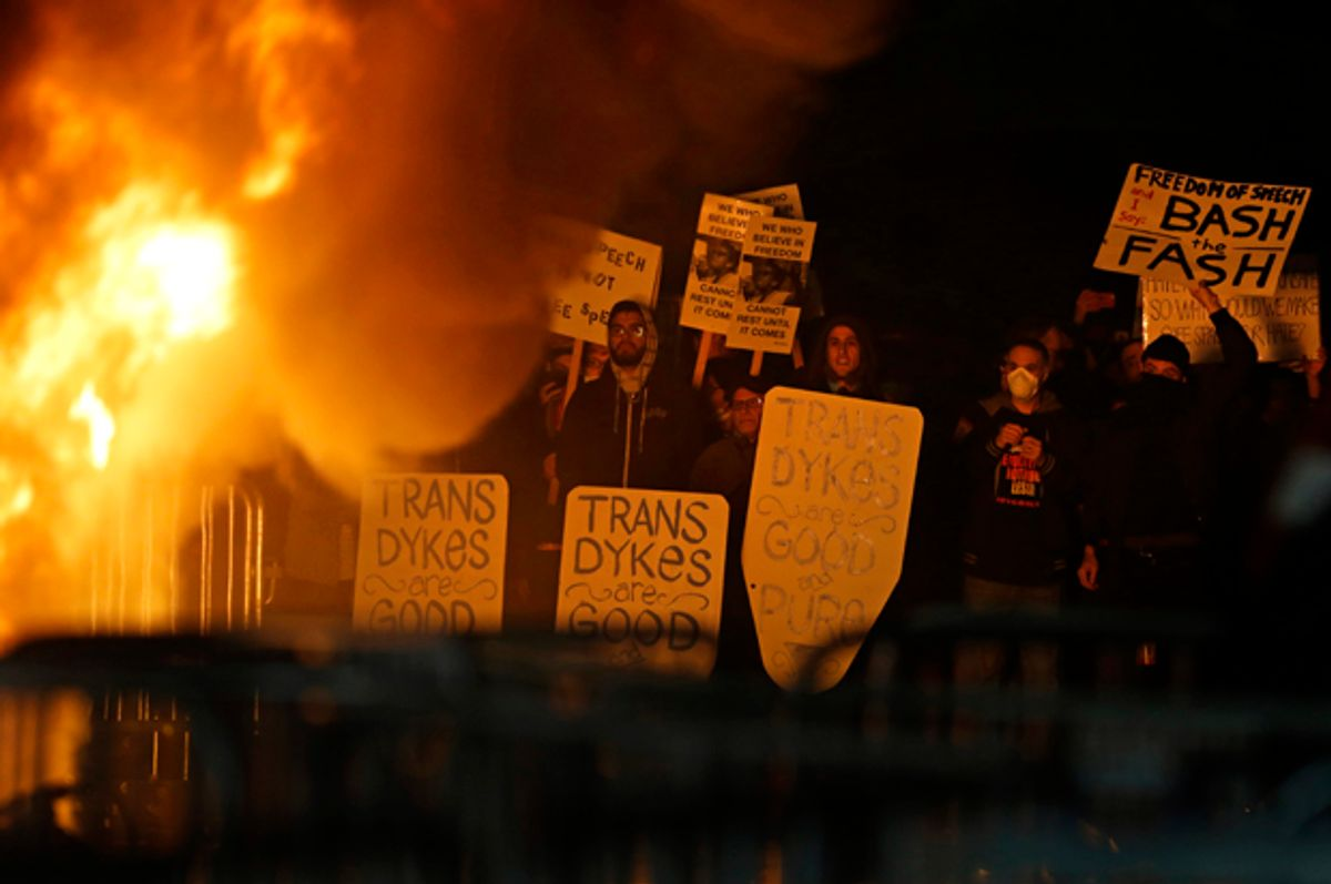 Protestors watch a fire on Sproul Plaza during a rally against the scheduled speaking appearance by Breitbart News editor Milo Yiannopoulos on the University of California at Berkeley campus on Wednesday, Feb. 1, 2017   (AP/Ben Margot)