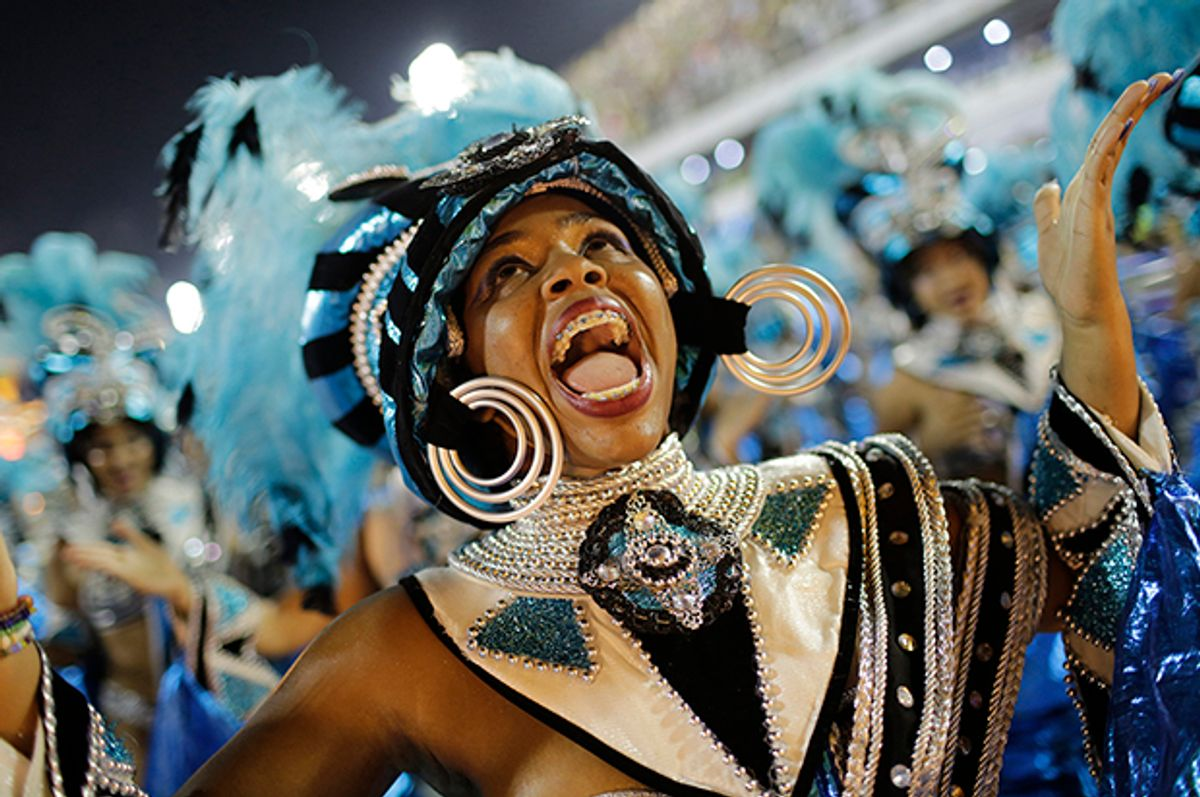 A performer from the Vila Isabel samba school parades during Carnival celebrations at the Sambadrome in Rio de Janeiro, Brazil, Monday, Feb. 27, 2017. (AP Photo/Silvia Izquierdo) (AP)