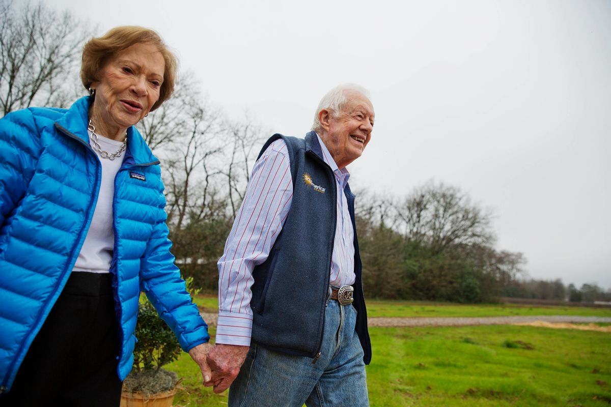 Former President Jimmy Carter, right, and his wife Rosalynn arrive for a ribbon cutting ceremony for a solar panel project on farmland he owns in their hometown of Plains, Ga., Wednesday, Feb. 8, 2017. Carter leased the land to Atlanta-based SolAmerica Energy, which owns, operates, and sells power generated from solar cells. The company estimates the project will provide more than half of the power needed in this town of 755 people. (AP Photo/David Goldman) (AP)
