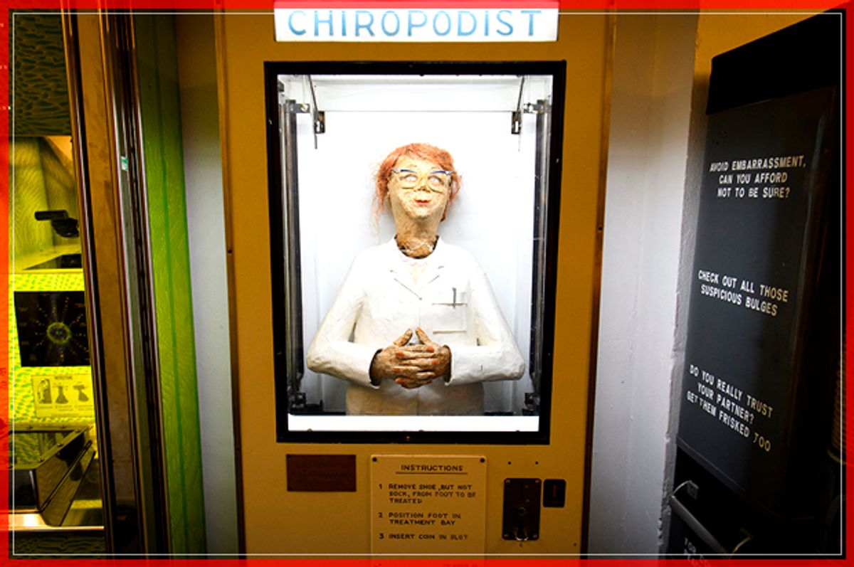 """LONDON, ENGLAND - FEBRUARY 15:  The automatic """"Chiropodist"""" machine is seen in the """"Novelty Automation"""" gallery on February 15, 2017 in London, England. The gallery includes a selection of handmade arcade-style satirical machines, ranging from an alien probe device to a machine that simulates trying to successfully climb the housing ladder, with or without the assistance of the """"Bank of Mum and Dad"""".  (Photo by Leon Neal/Getty Images) (Getty Images)"""