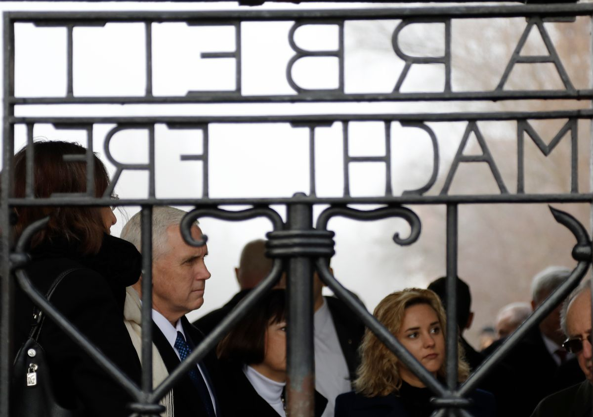 """U.S. Vice President Mike Pence, his wife Karen and his daughter Charlotte, from left, stand behind the gate with the infamous writing """"Work sets you free"""" as they visit the former Nazi concentration camp in Dachau near Munich, southern Germany, Sunday, Feb. 19, 2017, one day after he attended the Munich Security Conference. (AP Photo/Matthias Schrader) (AP)"""