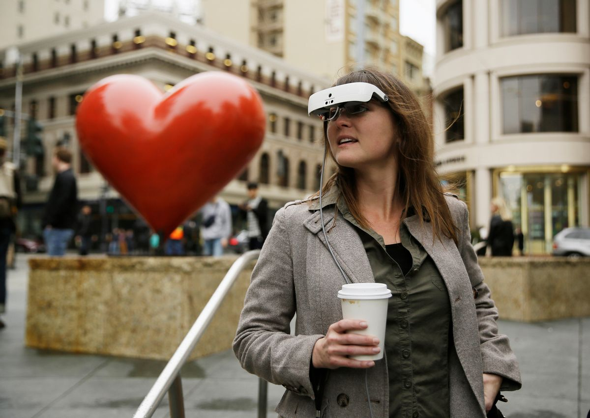 In this photo taken Thursday, Feb. 2, 2017, Yvonne Felix wears eSight electronic glasses and looks around Union Square during a visit to San Francisco. The glasses enable the legally blind to see. Felix was diagnosed with Stargardt's disease after being hit by a car at the age of seven. (AP Photo/Eric Risberg) (AP)