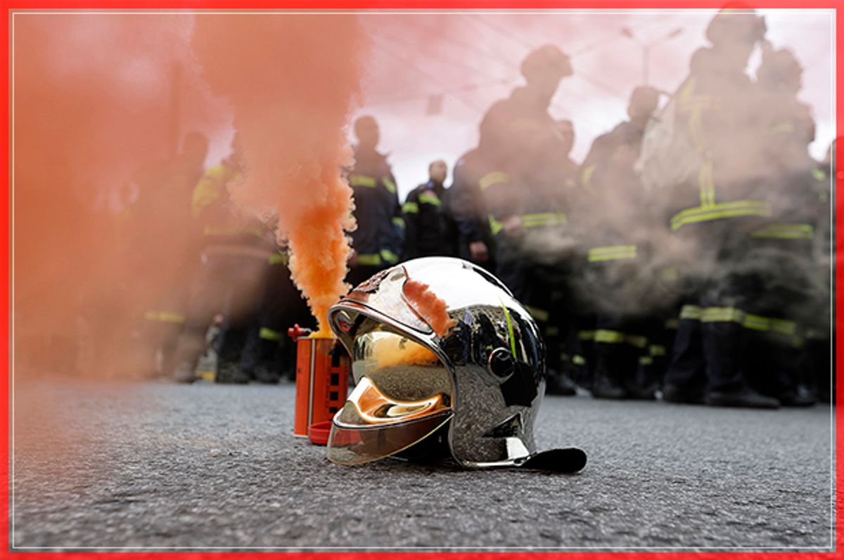 A firefighter's helmet stands next to a flare during a protest in central Athens, on Wednesday, Feb. 8 2017. Hundreds of firefighters in uniform have taken to the streets of the Greek capital to protest hiring conditions. (AP Photo/Thanassis Stavrakis) (Thanassis Stavrakis)