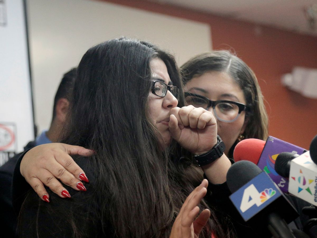 Marlene Mosqueda, left, who's father was deported early Friday, Feb. 10, 2017, is comforted at a news conference by her attorney Karla Navarrette at The Coalition for Humane Immigrant Rights of Los Angeles (CHIRLA). Navarrete, said she sought to stop Mosqueda from being placed on a bus to Mexico and was told by ICE that things had changed. She said another lawyer filed federal court papers to halt his removal. (AP Photo/Nick Ut) (AP)