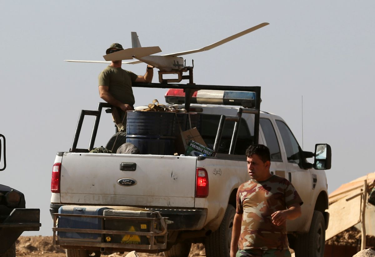 In this Friday, Oct. 21, 2016 photo, a U.S. soldier, left, prepares to launch a drone in a joint base with Iraqi army on the outskirts of Mosul, Iraq. Reverberations from President Donald Trump's travel ban and other stances are threatening to undermine future U.S.-Iraqi security cooperation, rattling a key alliance that over the past two years has slowly beaten back the Islamic State group. Iraq's prime minister, Haider al-Abadi, has sought to contain public anger sparked by the ban and by Trump's repeated statements that the Americans should have taken Iraq's oil, as well as his hard line against Iran, a close ally of Baghdad. (AP Photo/Khalid Mohammed) (AP)