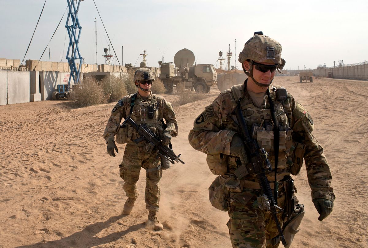 FILE - In this Nov. 9, 2016 file photo, U.S. Army soldiers move through Qayara West Coalition base in Qayara, some 50 kilometers south of Mosul, Iraq. Reverberations from President Donald Trump's travel ban and other stances are threatening to undermine future U.S.-Iraqi security cooperation, rattling a key alliance that over the past two years has slowly beaten back the Islamic State group. Iraq's prime minister, Haider al-Abadi, has sought to contain public anger sparked by the ban and by Trump's repeated statements that the Americans should have taken Iraq's oil, as well as his hard line against Iran, a close ally of Baghdad. (AP Photo/Marko Drobnjakovic, File) (AP)