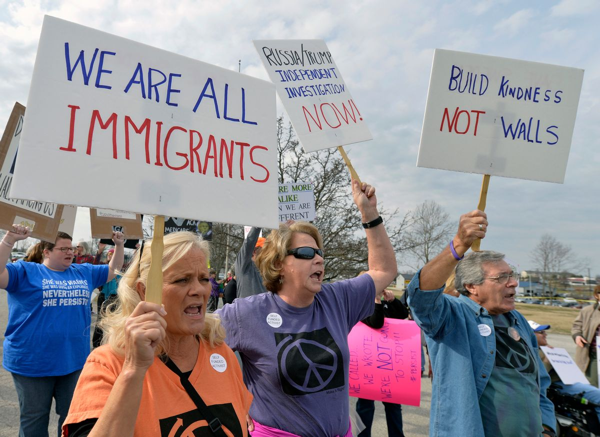 A group numbering in the hundreds gather outside the American Legion Post 34 to protest the appearance of Senate Majority Leader Mitch McConnell R-Ky., and the policies of the Trump administration Tuesday, Feb. 21, 2017, in Lawrenceburg, Ky. () (AP Photo/Timothy D. Easley)