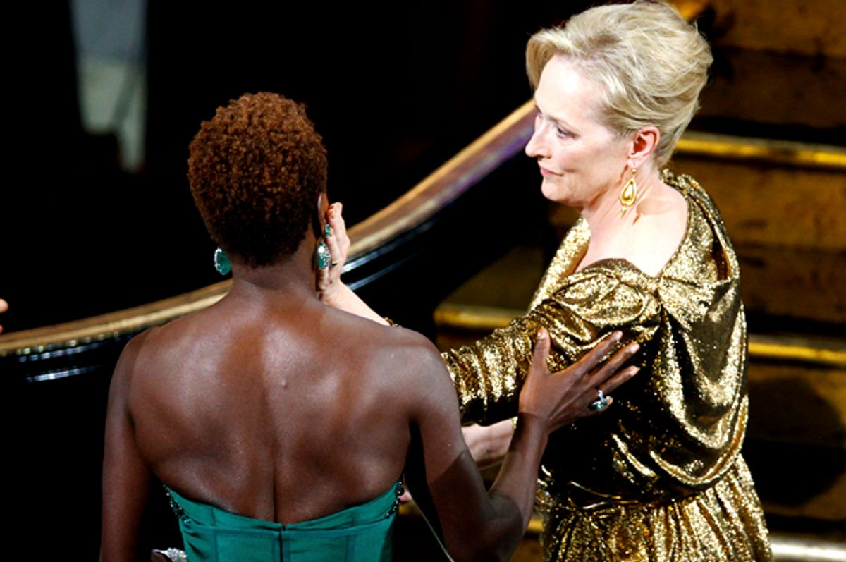 """Meryl Streep, winner of the Oscar for best actress for her role in """"The Iron Lady"""" is congratulated by fellow nominee Viola Davis   (Reuters/Gary Hershorn)"""