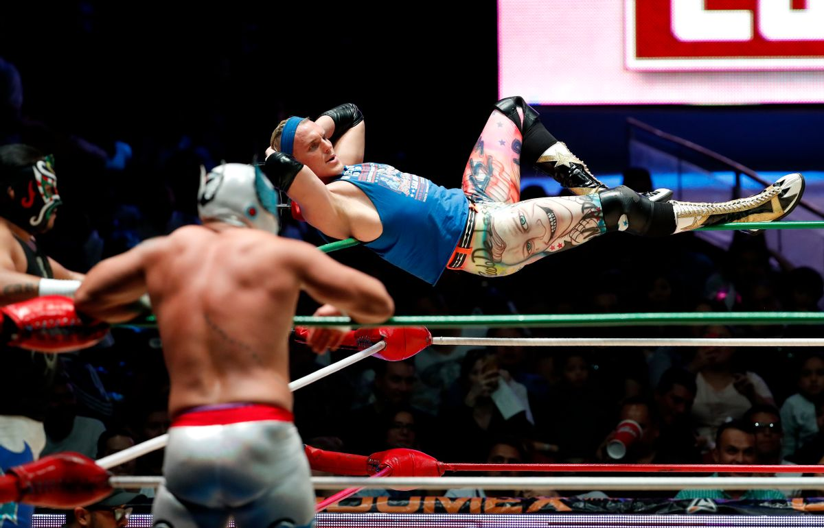 """Pro wrestler Sam Polinsky working under the name of Sam Adonis balances himself on the corner ropes during a bout at Arena Mexico in Mexico City, Sunday, Feb. 12, 2017. A native of Pittsburgh, Polinsky came to Mexico last year and the Trump campaign gave him the unparalleled chance to play the ultimate ring villain. """"What they want to say to Donald Trump they can say to me and feel good about it,"""" he says. (AP Photo/Eduardo Verdugo) (AP)"""