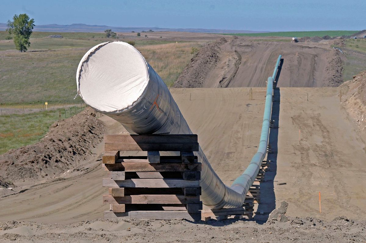 FILE - This Sept. 29, 2016, file photo, shows a section of the Dakota Access Pipeline under construction near the town of St. Anthony in Morton County, N.D. The Army has notified Congress Tuesday, Feb. 7, 2017, that it will allow the $3.8 billion Dakota Access pipeline to cross under a Missouri River reservoir in North Dakota, completing the four-state project to move North Dakota oil to Illinois. The Army intends to allow the crossing under Lake Oahe as early as Wednesday, Feb. 8. The crossing is the final big chunk of work on the pipeline.  (Tom Stromme/The Bismarck Tribune via AP, File) (AP)