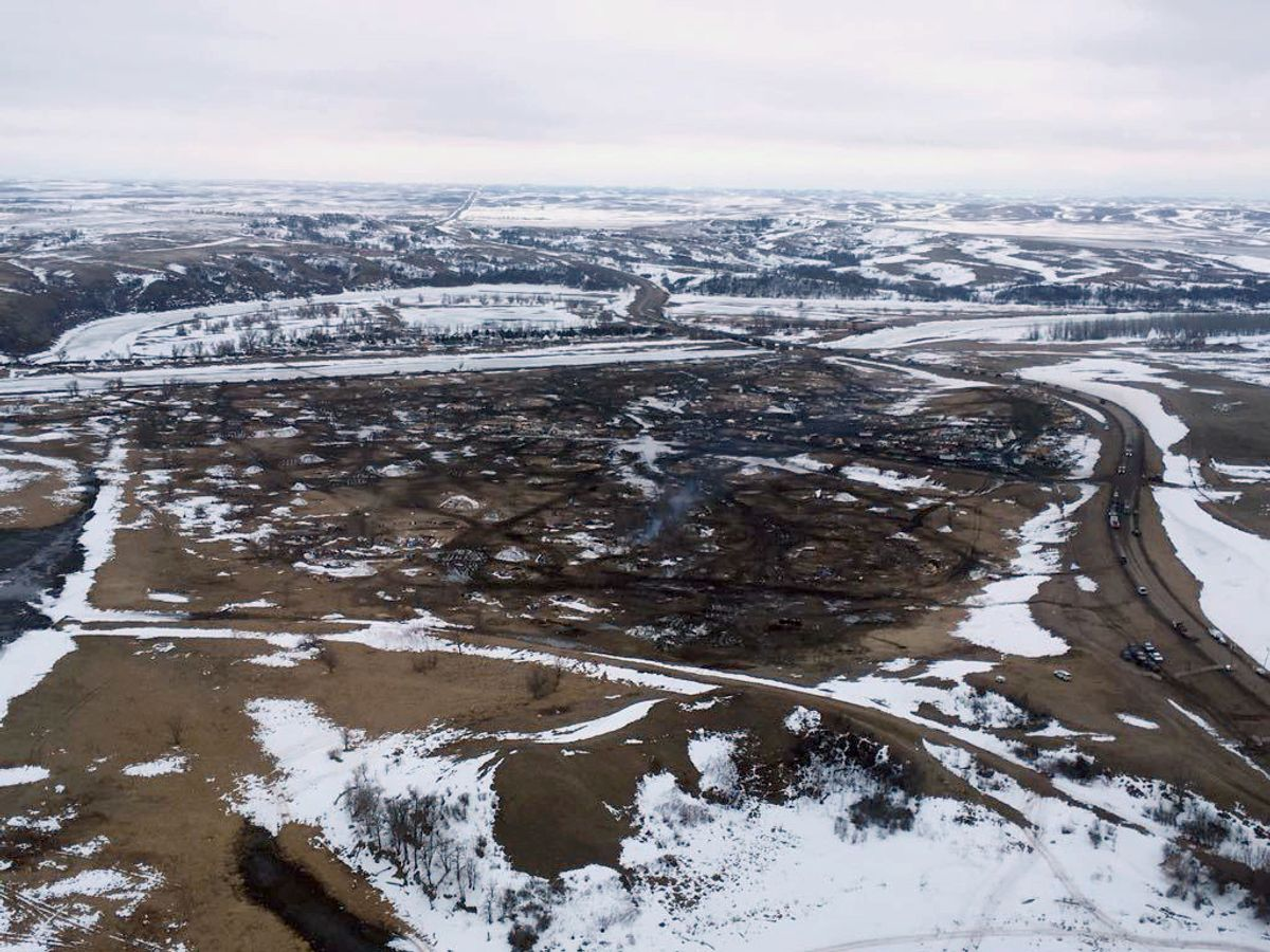 This aerial photo provided the Morton County Sheriff Department shows the closed Dakota Access pipeline protest camp near Cannon Ball, N.D., Thursday, Feb. 23, 2017.  Authorities on Thursday cleared the camp where opponents of the pipeline had gathered for the better part of a year, searching tents and huts and arresting dozens of holdouts who had defied a government order to leave. (Morton County Sheriff Department via AP) (AP)