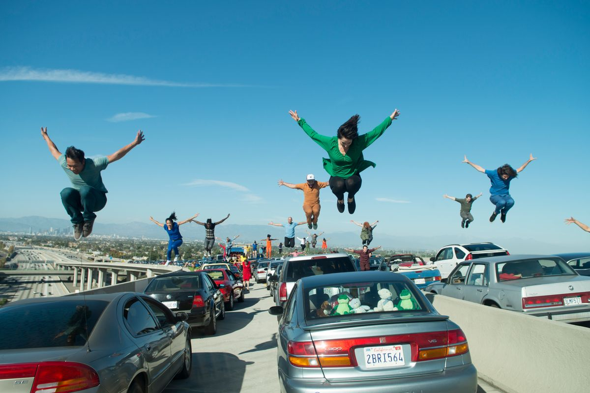 """This image released by Lionsgate shows a dance scene from the Oscar-nominated film, """"La La Land."""" It's not easy to stage a successful dance scene for the cameras, especially on a highway interchange, but when such a scene works, it can be memorable.  (Dale Robinette/Lionsgate via AP) (AP)"""