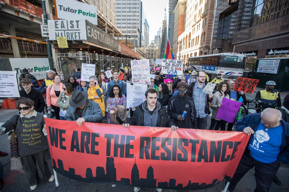 People march during a protest Monday, Feb. 20, 2017, in Philadelphia. Thousands of demonstrators turned out Monday across the U.S. to challenge Donald Trump in a Presidents Day protest dubbed Not My President's Day. (Michael Bryant/The Philadelphia Inquirer via AP) (AP)