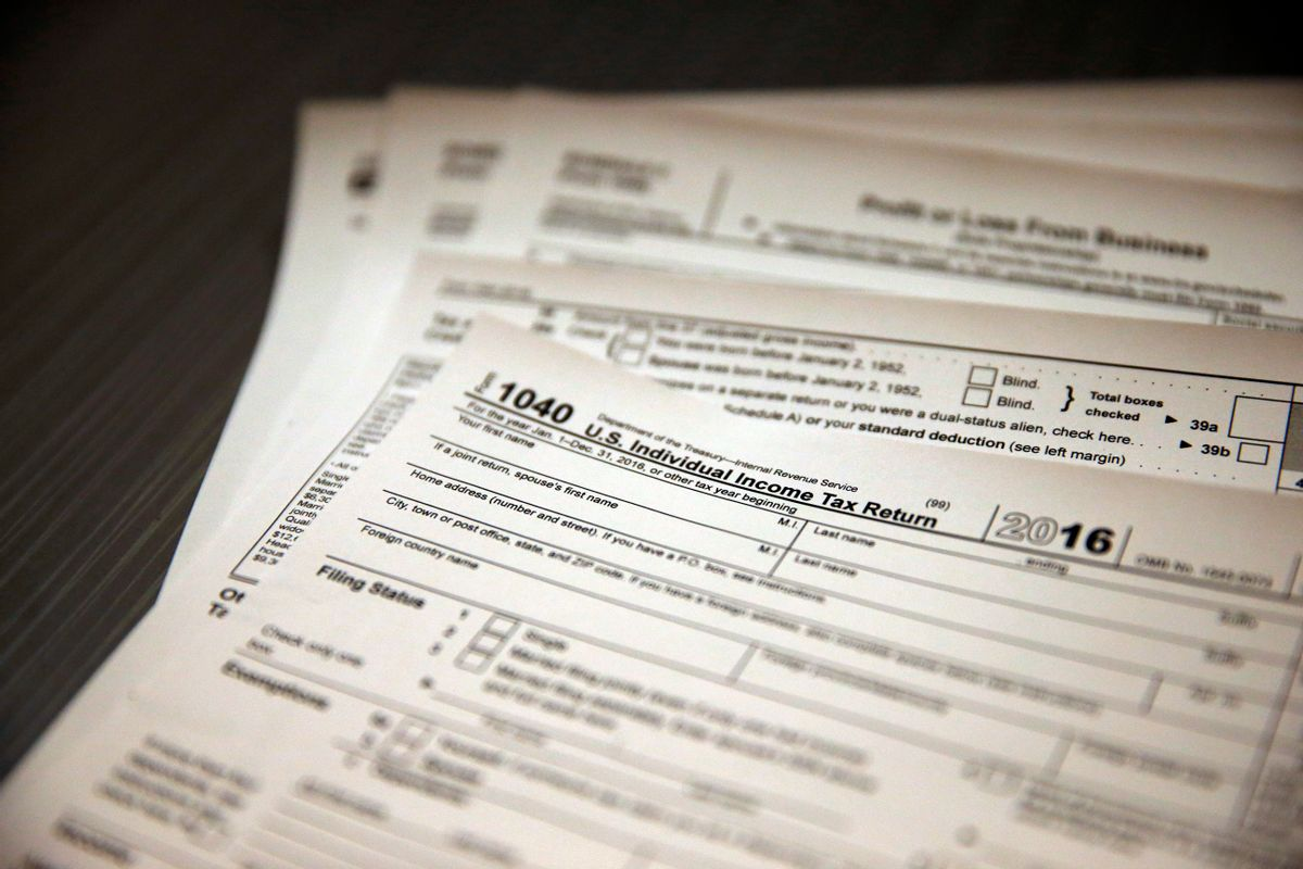 In this Jan. 14, 2017, photo, tax forms sit on a desk at the start of the tax season rush, inside the offices of tax preparation firm Infinite Tax Solutions, in Boulder, Colo. Filing taxes early could speed your return and protect your identity. (AP Photo/Brennan Linsley) (AP)