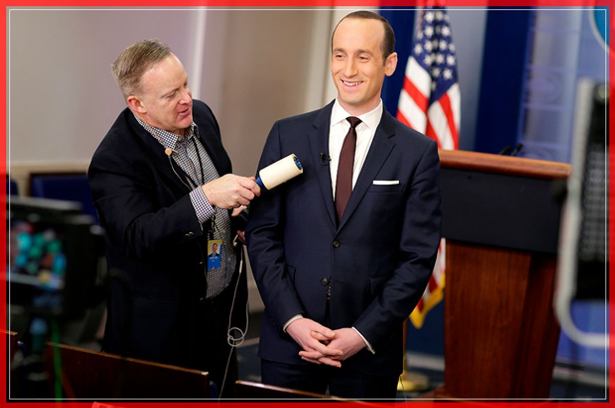 White House Press Secretary Sean Spicer removes lint from Senior White House Advisor Stephen Miller's jacket as he waits to go on the air in the White House Briefing Room in Washington, U.S., February 12, 2017. REUTERS/Joshua Roberts TPX IMAGES OF THE DAY - RTSYA0N (Reuters)