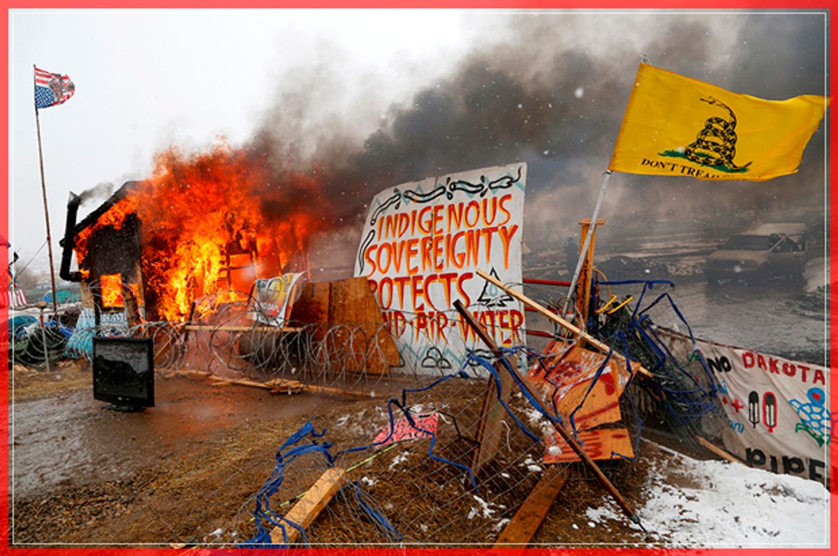 A structure burns after being set alight by protesters preparing to evacuate the main opposition camp against the Dakota Access oil pipeline near Cannon Ball, North Dakota, U.S., February 22, 2017. REUTERS/Terray Sylvester     TPX IMAGES OF THE DAY - RTSZW7D (Reuters)