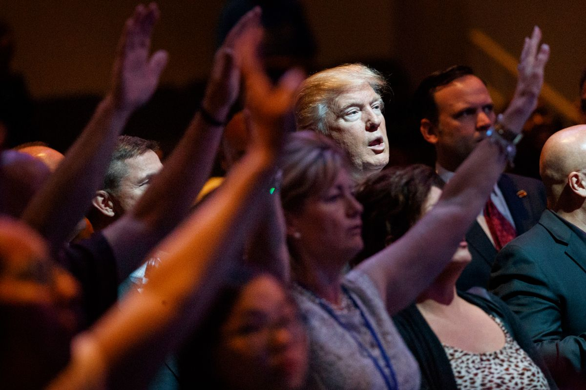 FILE- In this Oct. 30, 2016, file photo, Republican presidential candidate Donald Trump stands during a service at the International Church of Las Vegas in Las Vegas. President Trump's pledge to scrap limits on church political activity could have sweeping effects that extend beyond his conservative supporters to more liberal congregations, including the black evangelical church that has long helped anchor the Democratic Party's electoral machinery. (AP Photo/Evan Vucci, File) (AP)