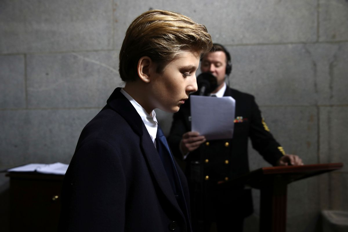 """FILE - In this Jan. 20, 2017, file photo, Barron Trump arrives on the West Front of the U.S. Capitol  in Washington, for the inauguration ceremony of Donald J. Trump as the 45th president of the United States. Think it's tough to be a kid? Try being a """"first kid"""" - the child of an American president. (Win McNamee/Pool Photo via AP, File) (AP)"""