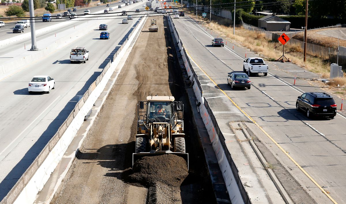 FILE - In this Oct. 15, 2015, file photo, vehicles pass a highway construction site on Interstate 80 in Sacramento, Calif. A plan to revitalize America's aging infrastructure put forward by two President Donald Trump administration economic advisers relies on a transportation financing scheme that hasn't been tried before and comes with significant risks. (AP Photo/Rich Pedroncelli, File) (AP)