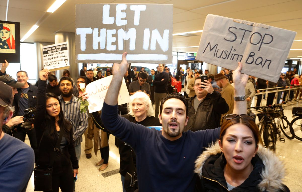 Supporters cheer as an Iranian citizen with a valid U.S. visa arrives at Los Angeles International Airport. (AP)