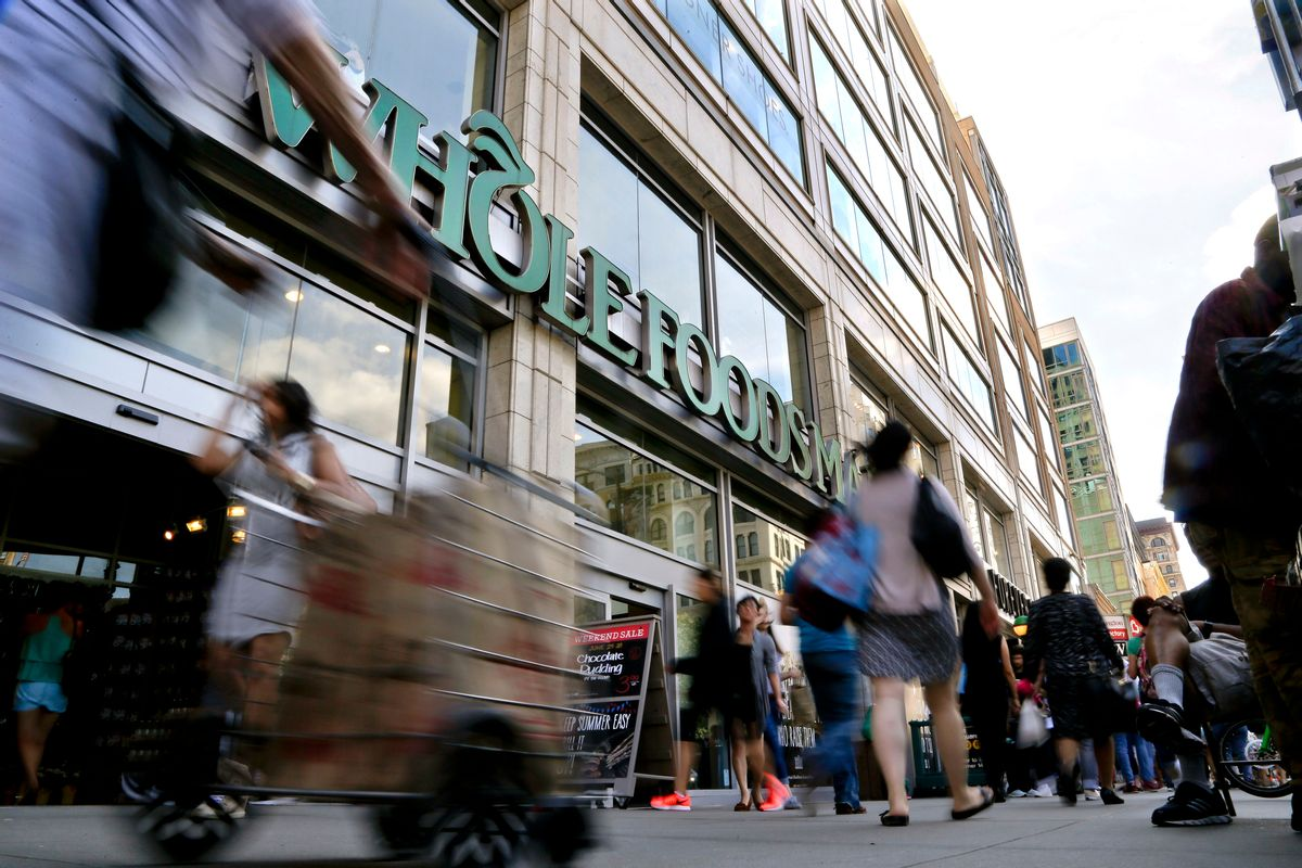 FILE - In this Wednesday, June 24, 2015, file photo, pedestrians pass in front of a Whole Foods Market store in Union Square in New York. Whole Foods said Wednesday, Feb. 8, 2017, that sales fell 2.4 percent at established locations, marking the sixth straight quarter of declines as it faces competitive pressures. (AP Photo/Julie Jacobson, File) (AP)