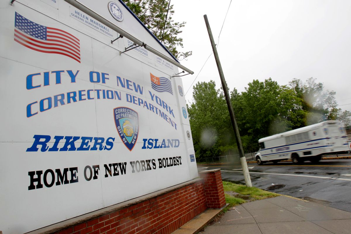 In this May 17, 2011, file photo, a New York City Department of Corrections bus passes the sign near the gate at the Rikers Island jail complex in New York. (AP Photo/Seth Wenig, File)