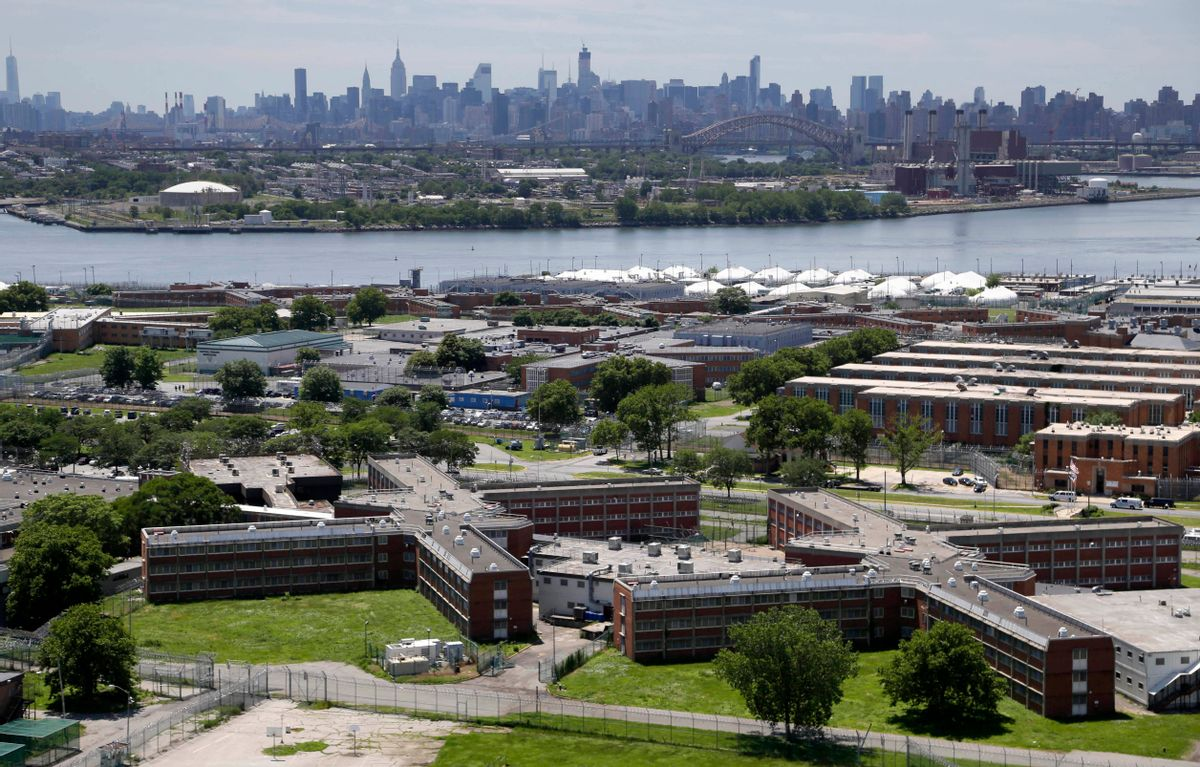 FILE - In this this June 20, 2014, file photo, the Rikers Island jail complex stands in the foreground with the New York skyline in the background. Inmate activists, for more than a year, have argued that shutting down the sprawling, 10-jail complex in the East River is the only solution for a cycle of abuses that include violence by guards and gang members, mistreatment of the mentally ill and juveniles, and unjustly long detention for minor offenders. (AP Photo/Seth Wenig, File) (AP)