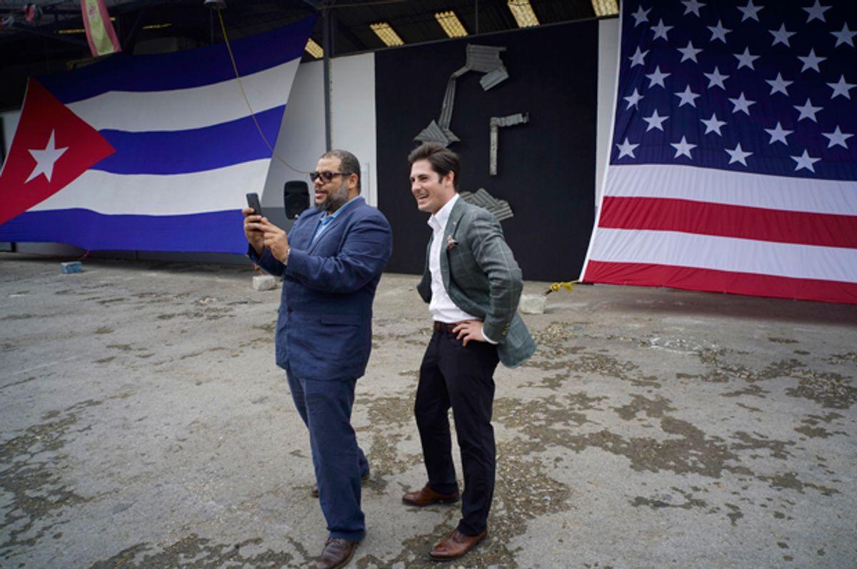 Google's head of Cuba operations, Brett Perlmutter, and Alexis Leiva Machado, a Cuban sculptor, take a selfie at the entrance of a new Google technology center in Havana, Cuba, March 21, 2016.   (AP/Ramon Espinosa)