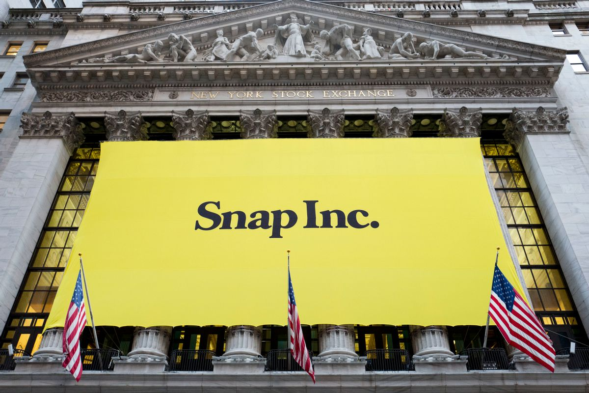 A banner for Snap Inc. hangs from the front of the New York Stock Exchange, Thursday, March 2, 2017, in New York. The company behind the popular messaging app Snapchat is expected to start trading Thursday after a better-than-expected stock offering. (AP Photo/Mark Lennihan) (AP)