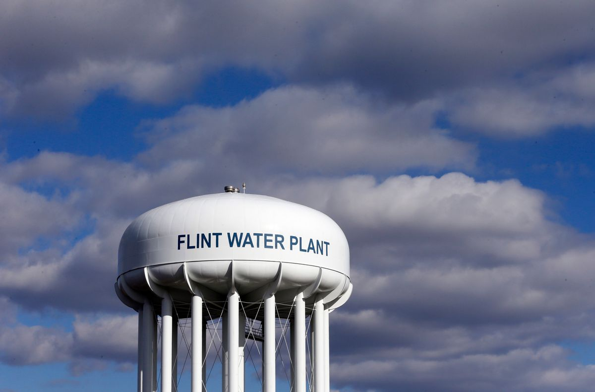 FILE - In this March 21, 2016 file photo, the Flint Water Plant water tower is seen in Flint, Mich. The Trump administration would slash programs aimed at slowing climate change and improving water safety and air quality, while eliminating thousands of jobs, according to a draft of the Environmental Protection Agency budget proposal obtained by the Associated Press.  (AP Photo/Carlos Osorio, File) (AP)