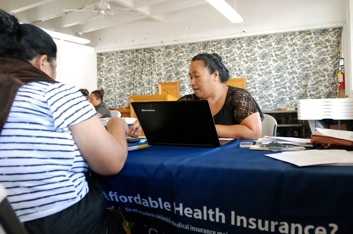 FILE - In this Jan. 30, 2017 file photo, Cinder Sonis, right, an advocate with Legal Aid Society of Hawaii, helps a customer enroll in an Affordable Care Act health insurance plan in Honolulu. Allowing insurers to market health care policies across state lines is one of President Donald Trump's main ideas for bringing down costs. While supporters of the idea cast it as a way to make insurance policies more competitive, critics say it's unlikely to result in more affordable plans and could undermine stronger consumer protections in states such as California and Hawaii. (AP Photo/Cathy Bussewitz, File) (AP)