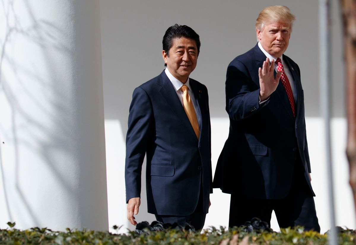 FILE - In this Feb. 10, 2017, file photo, Japanese Prime Minister Shinzo Abe, left, and U.S. President Donald Trump walk together to a news conference at the White House in Washington. (AP Photo/Evan Vucci, File)