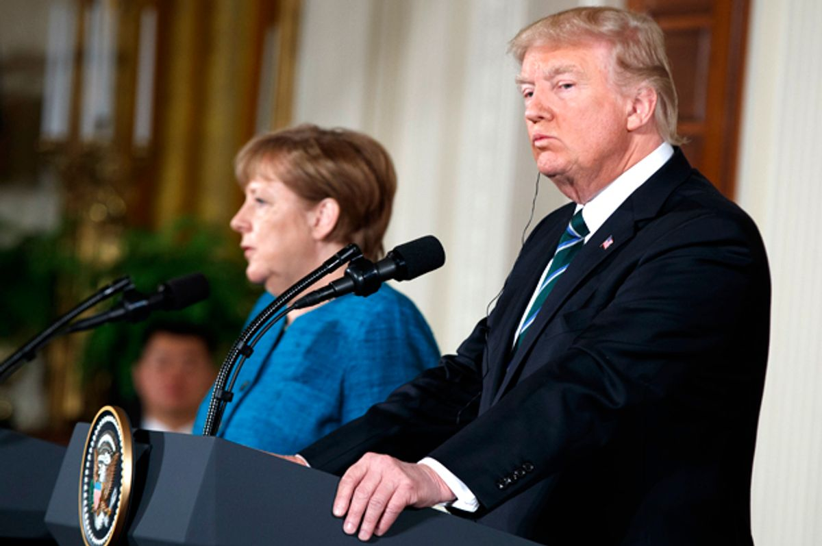 Donald Trump looks and Angela Merkel at a news conference in the White House, March 17, 2017.   (AP/Evan Vucci)