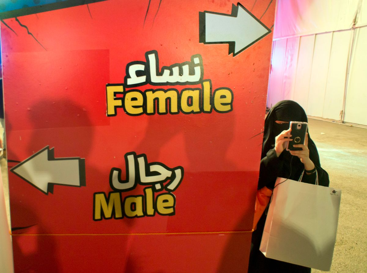 FILE - In this Friday, Feb. 17, 2017, file photo, a visitor takes pictures at the entrance of the female section, during the Saudi Comic Con (SCC) which is the first event of its kind to be held in Jiddah, Saudi Arabia. The kingdom, which bans movie theaters and other entertainment venues, is challenging its ultraconservative image and loosening the reins on fun by opening its doors to live shows, including some American ones. (AP Photo, File) (AP)
