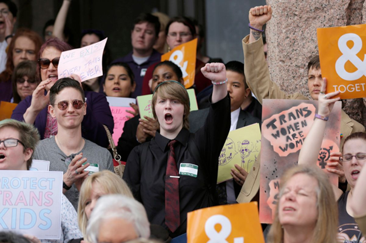 Members of the transgender community take part in a rally on the steps of the Texas Capitol, Monday, March 6, 2017, in Austin, Texas.   (AP/Eric Gay)