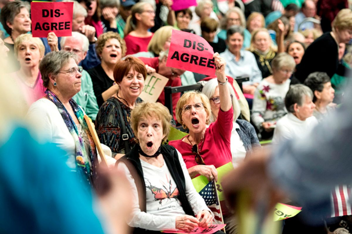 People in the crowd respond to a woman supporting President Donald Trump during a town hall meeting with Rep. Mark Sanford (R-SC)    (Getty/Sean Rayford)