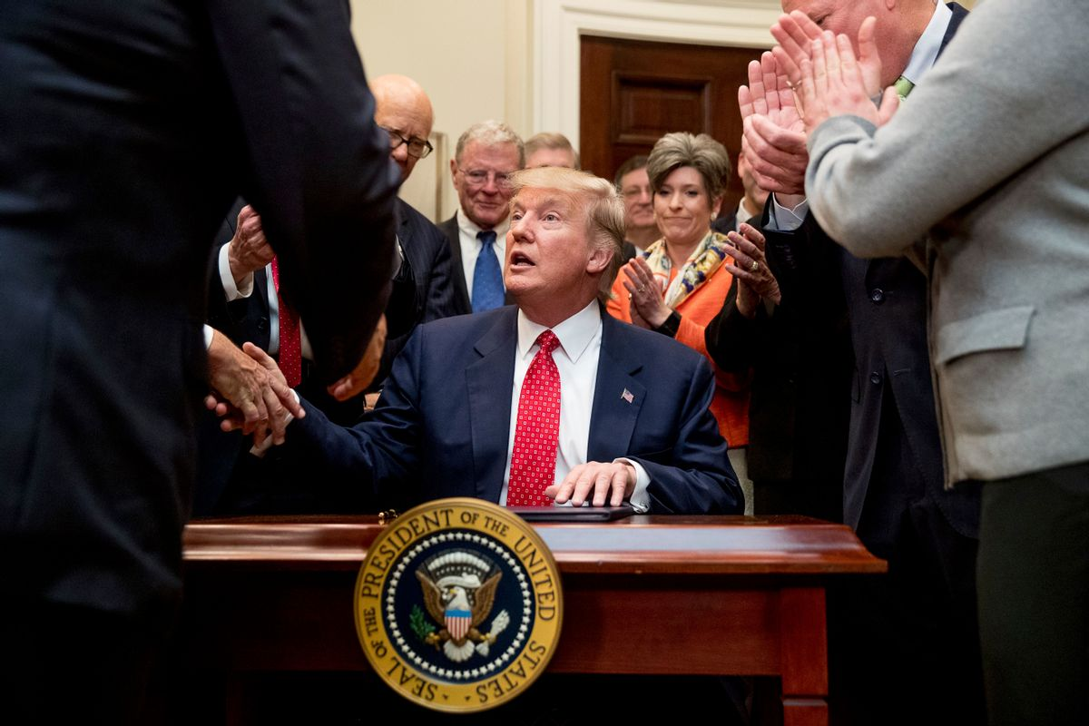 President Donald Trump signs the Waters of the United States (WOTUS) executive order, Tuesday, Feb. 28, 2017. (AP Photo/Andrew Harnik)