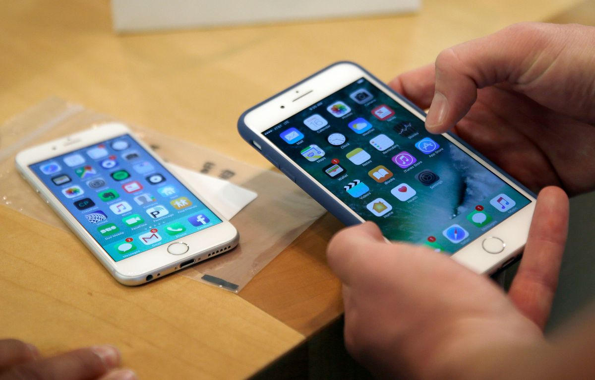 FILE - In this Friday, Sept. 16, 2016, file photo, a customer sets up his new iPhone 7 Plus, right, as he switches from the iPhone 6 at the Apple Store on Michigan Avenue during the release of the Apple iPhone 7 and the latest Apple Watches, in Chicago.  (AP Photo/Kiichiro Sato, File) (AP)