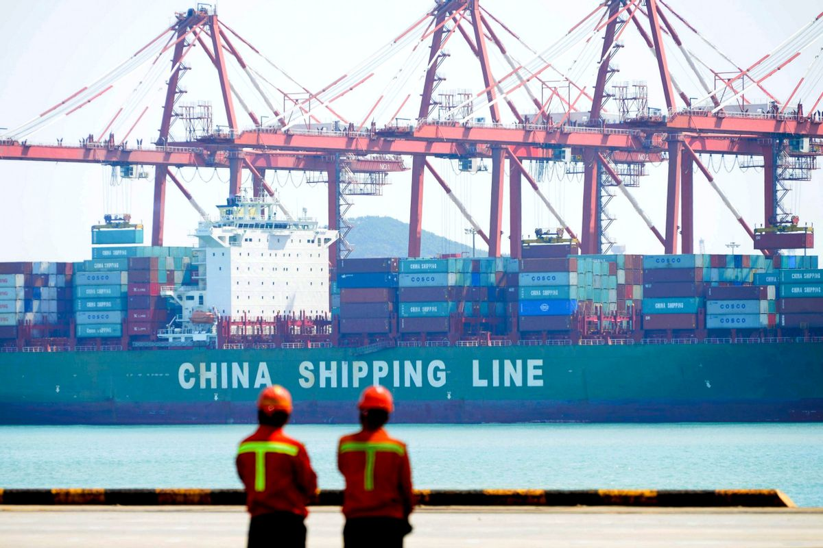 Workers stand watch as containers are loaded into a cargo ship at Qingdao Port in Qingdao in east China's Shandong province, Thursday, April 13, 2017. China's export growth accelerated in March in a positive sign for global demand, though import growth cooled. (Chinatopix via AP) (Chinatopix via AP)