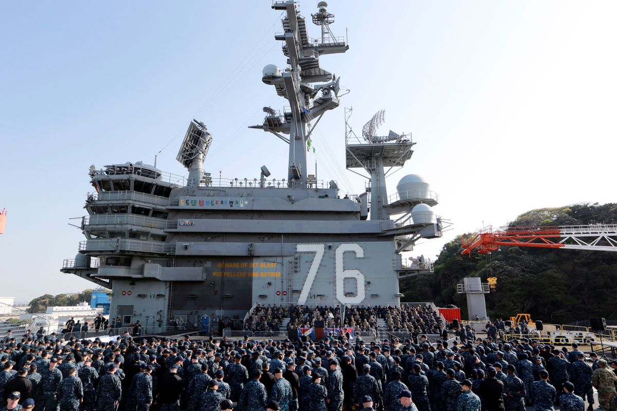 U.S. servicemen and Japanese Self-Defense Forces personnel wait for the arrival of U.S. Vice President Mike Pence on the flight deck of U.S. navy nuclear-powered aircraft carrier USS Ronald Reagan, at the U.S. Navy's Yokosuka base in Yokosuka, south of Tokyo, Wednesday, April 19, 2017. (AP Photo/Eugene Hoshiko) (AP)