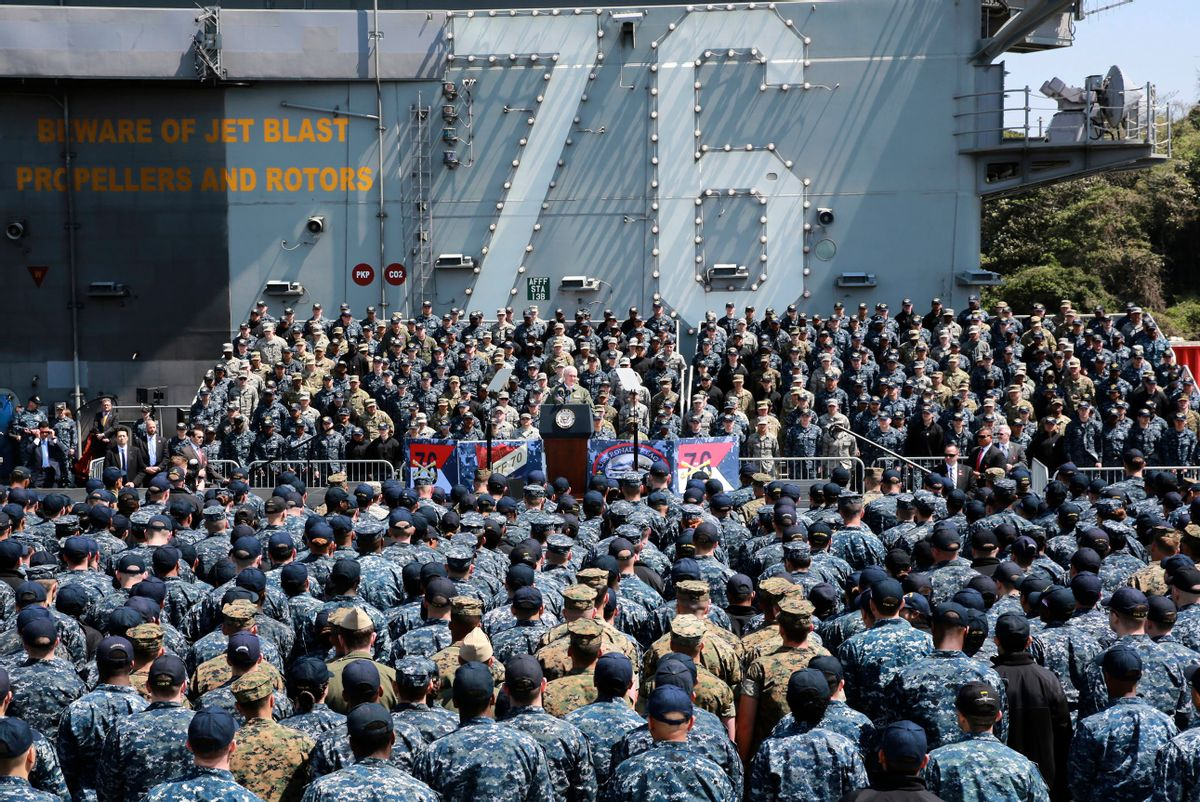 U.S. Vice President Mike Pence, center, speaks to U.S. servicemen and Japanese Self-Defense Forces personnel on the flight deck of U.S. navy nuclear-powered aircraft carrier USS Ronald Reagan, at the U.S. Navy's Yokosuka base in Yokosuka, south of Tokyo, Wednesday, April 19, 2017. (AP Photo/Eugene Hoshiko) (AP)