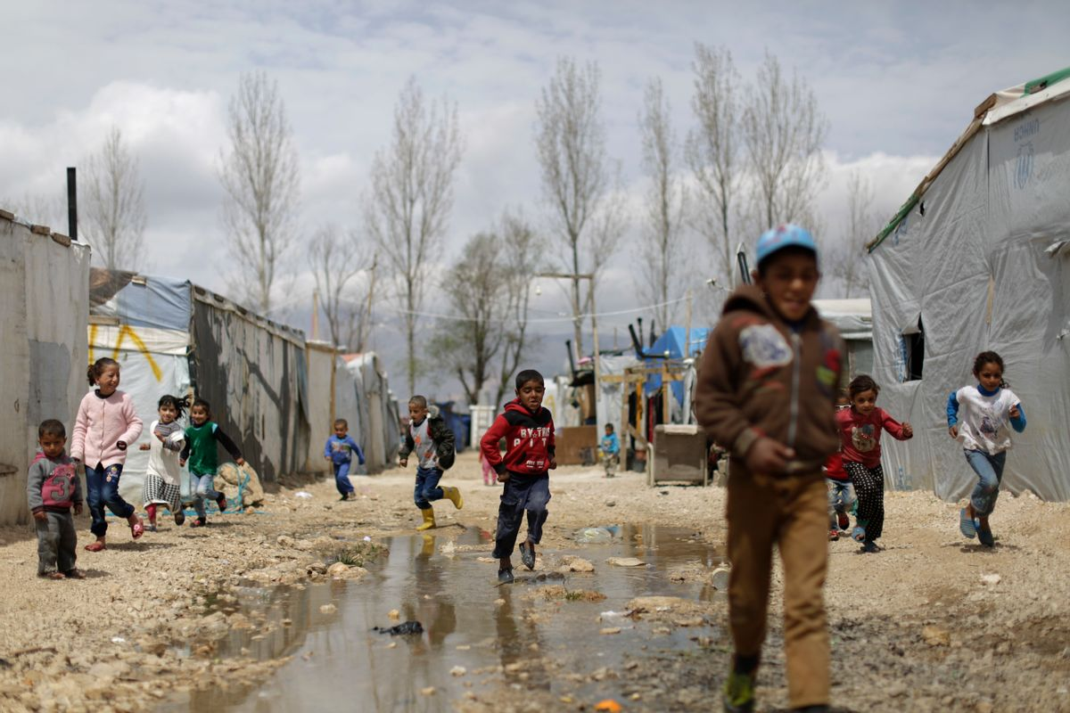 Syrian refugee children run at an informal refugee camp, at Al-Marj town in Bekaa valley, east Lebanon Lebanon, Saturday, April 8, 2017. For the millions of Syrian refugees scattered across camps and illegal settlements across the region, the chemical attack on a town in northern Syria and subsequent U.S. strike was a rare moment when the world briefly turned its attention to Syria, before turning away again.(AP Photo/Hassan Ammar) (AP)