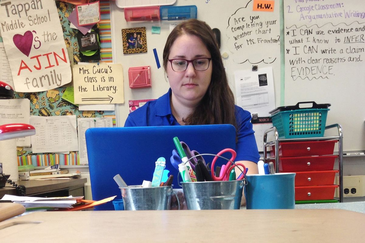 In this Monday, April 3, 2017, photo, Samantha Cucu types on a laptop inside her classroom at Tappan Middle School in Ann Arbor, Mich. (AP Photo/Mike Householder) (AP)