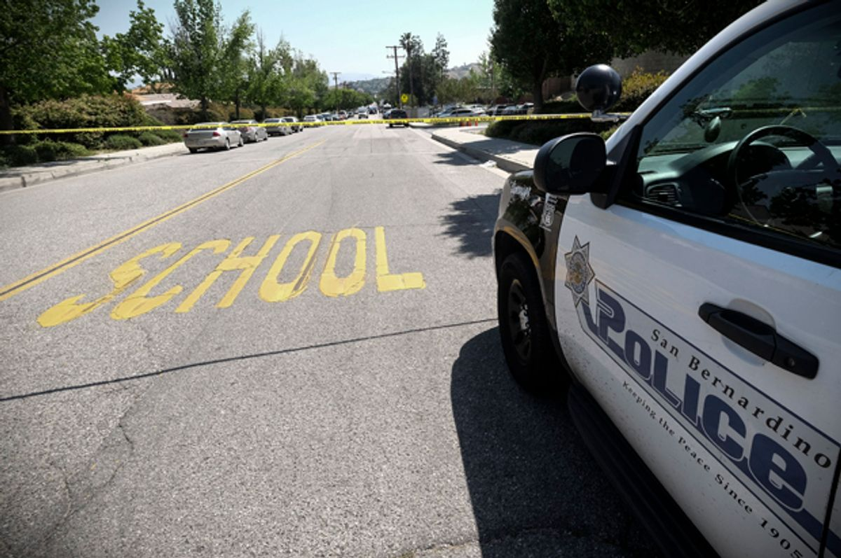 A police car is seen outside North Park School after a shooting, April 10, 2017, in San Bernardino, Calif.   (AP/Ringo H.W. Chiu)