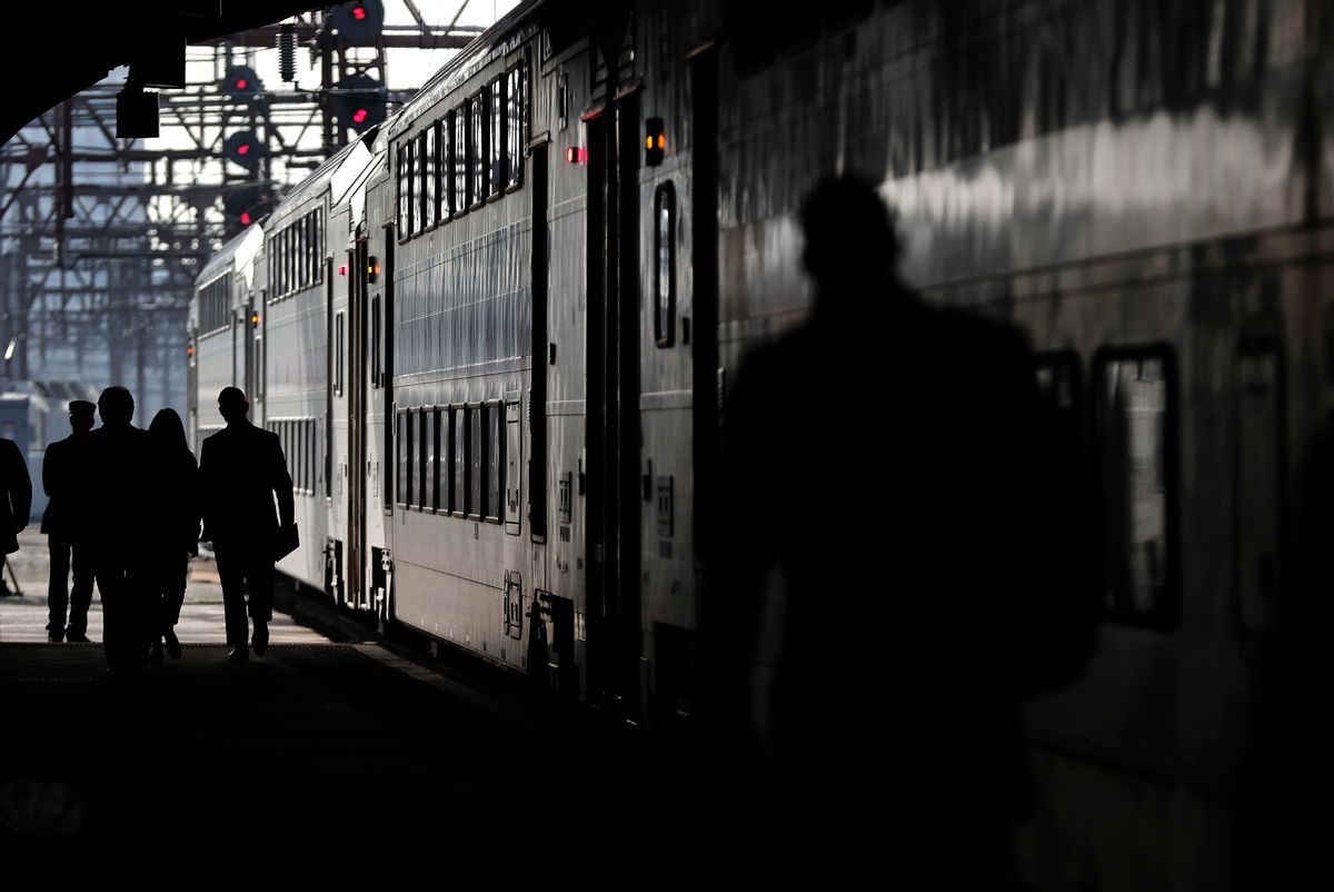 New Jersey Transit commuters walk along a platform to catch a train heading for Dover, N.J., Wednesday, April 5, 2017, in Hoboken, N.J. The heads of the two major commuter rail lines that use New York's Penn Station took turns criticizing Amtrak on Wednesday for two recent derailments that continued to cause headaches for commuters in the nation's busiest rail hub. (AP Photo/Julie Jacobson) (AP)