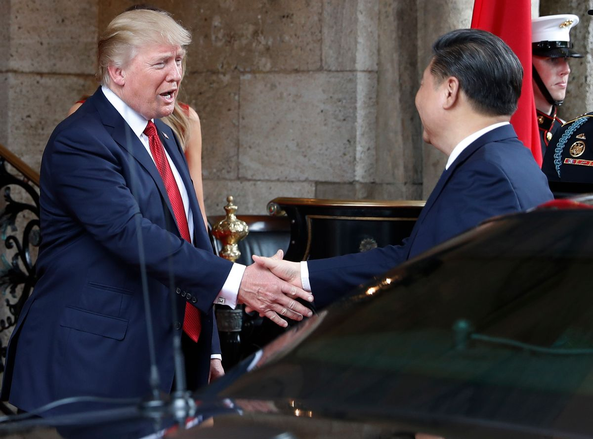 FILE - In this Thursday, April 6, 2017, file photo, President Donald Trump shakes hands with Chinese President Xi Jinping as he arrives before dinner at Mar-a-Lago resort, in Palm Beach, Fla. In recent weeks, Trump has moved away from his tough campaign rhetoric on trade. Trump's threat to slap harsh tariffs on Chinese goods has given way to a bid to mend fences with Beijing. (AP Photo/Alex Brandon, File) (AP)