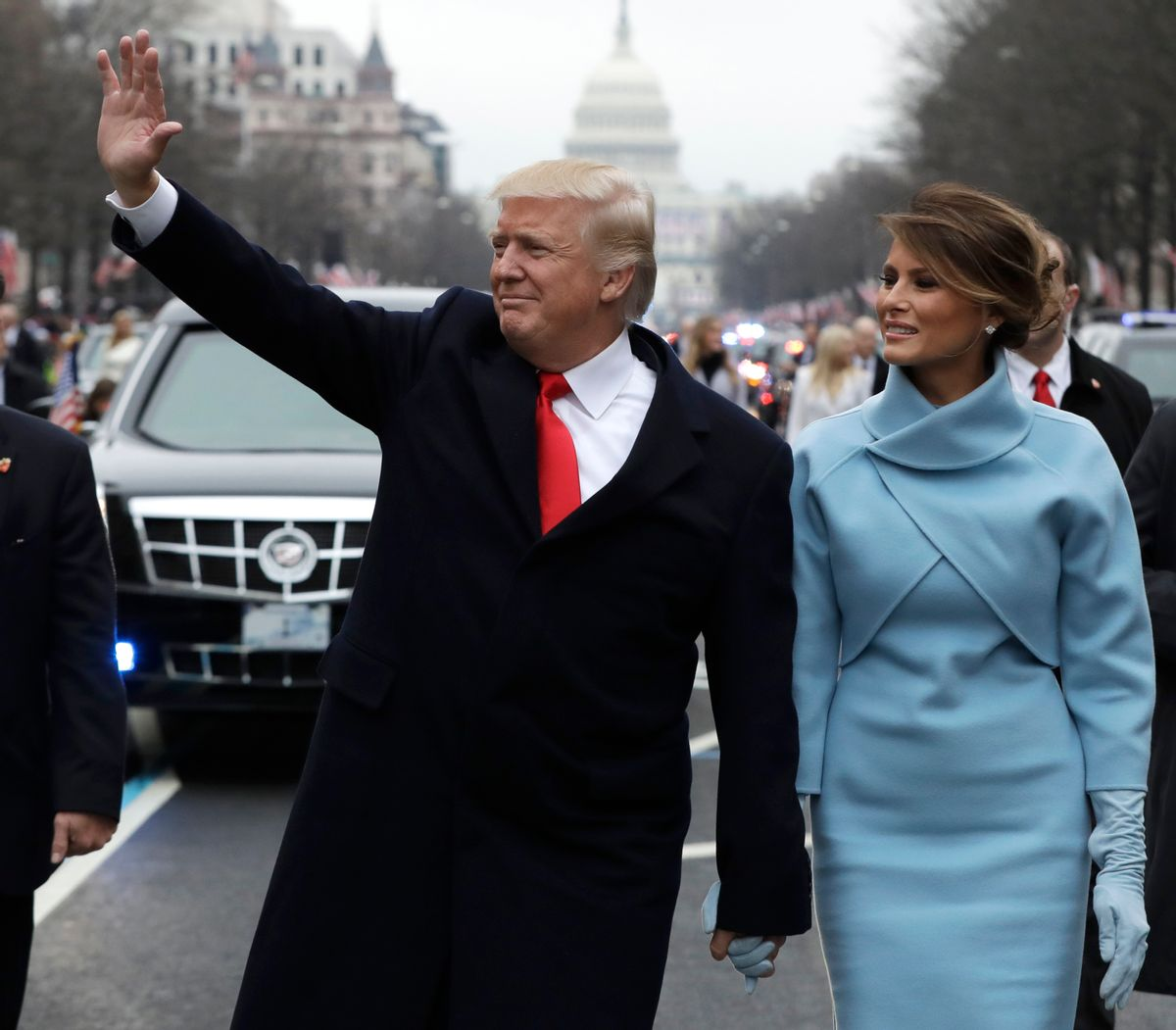 FILE- In this Jan. 20, 2017, file photo, President Donald Trump waves as he walks with first lady Melania Trump during the inauguration parade on Pennsylvania Avenue in Washington. Trump raised $107 million for his inaugural festivities. Trump's inaugural committee is due to file information about those donors with the Federal Election Commission and said it would do so on Tuesday, April 18. (AP Photo/Evan Vucci, Pool, File) (AP)