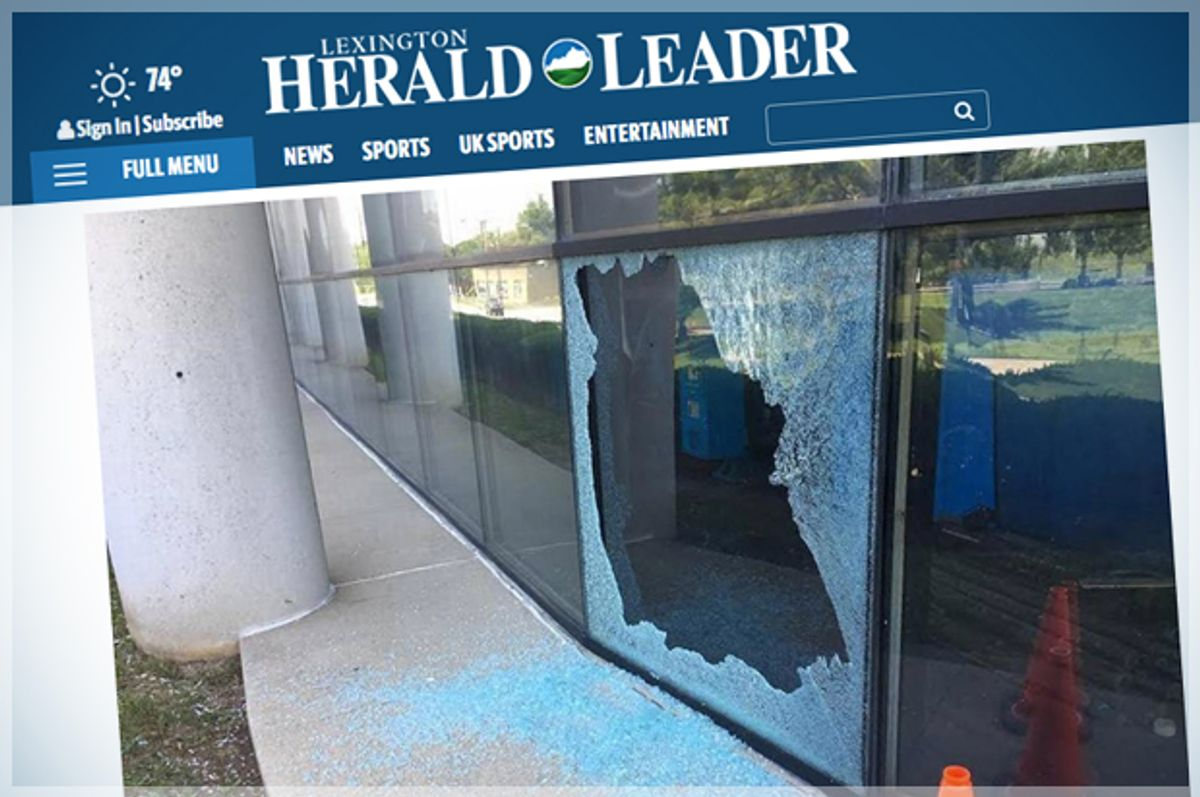 A shattered window at the Lexington Herald-Leader building.   (Lexington Herald Leader/Screen Montage by Salon)