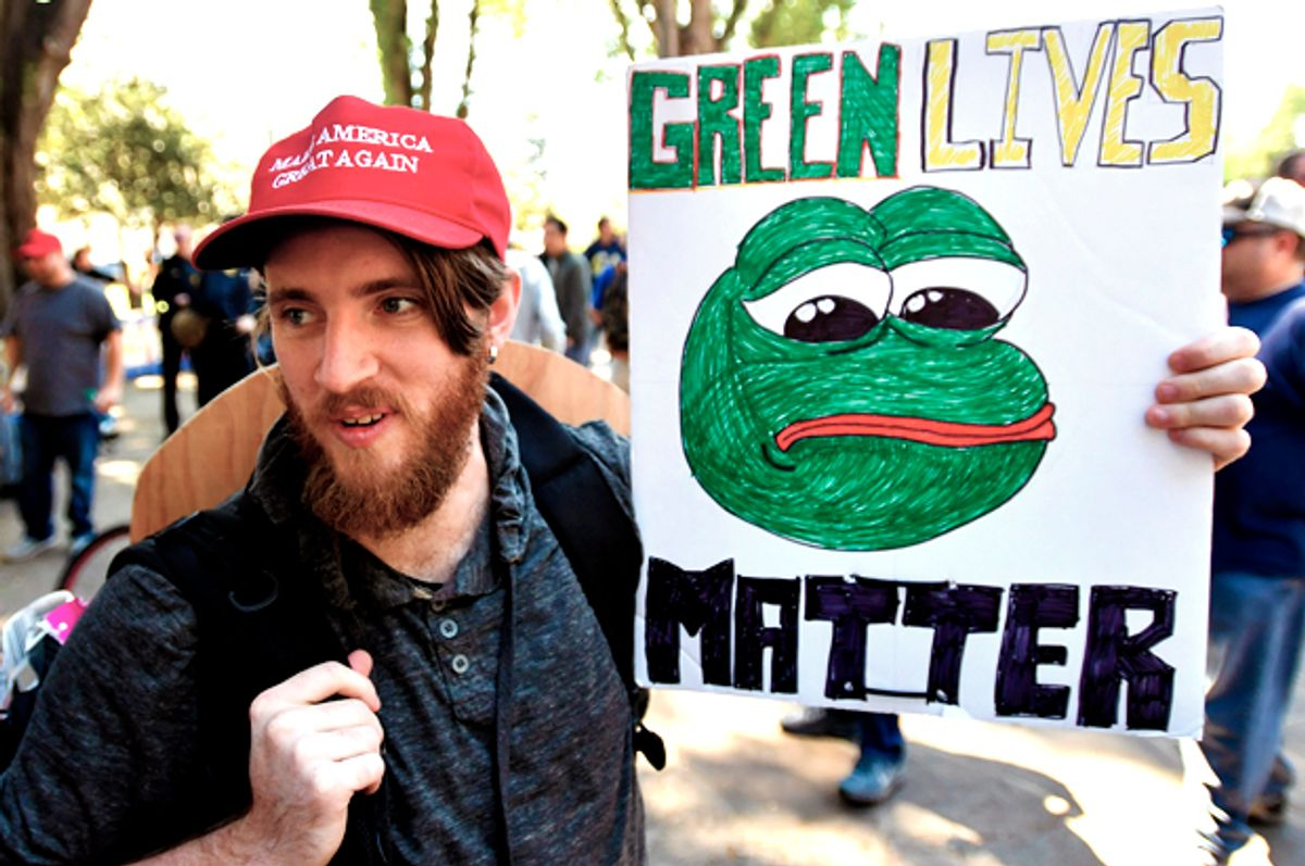A Trump supporter holds a sign bearing the image of Pepe the Frog.  (Getty/Josh Edelson)