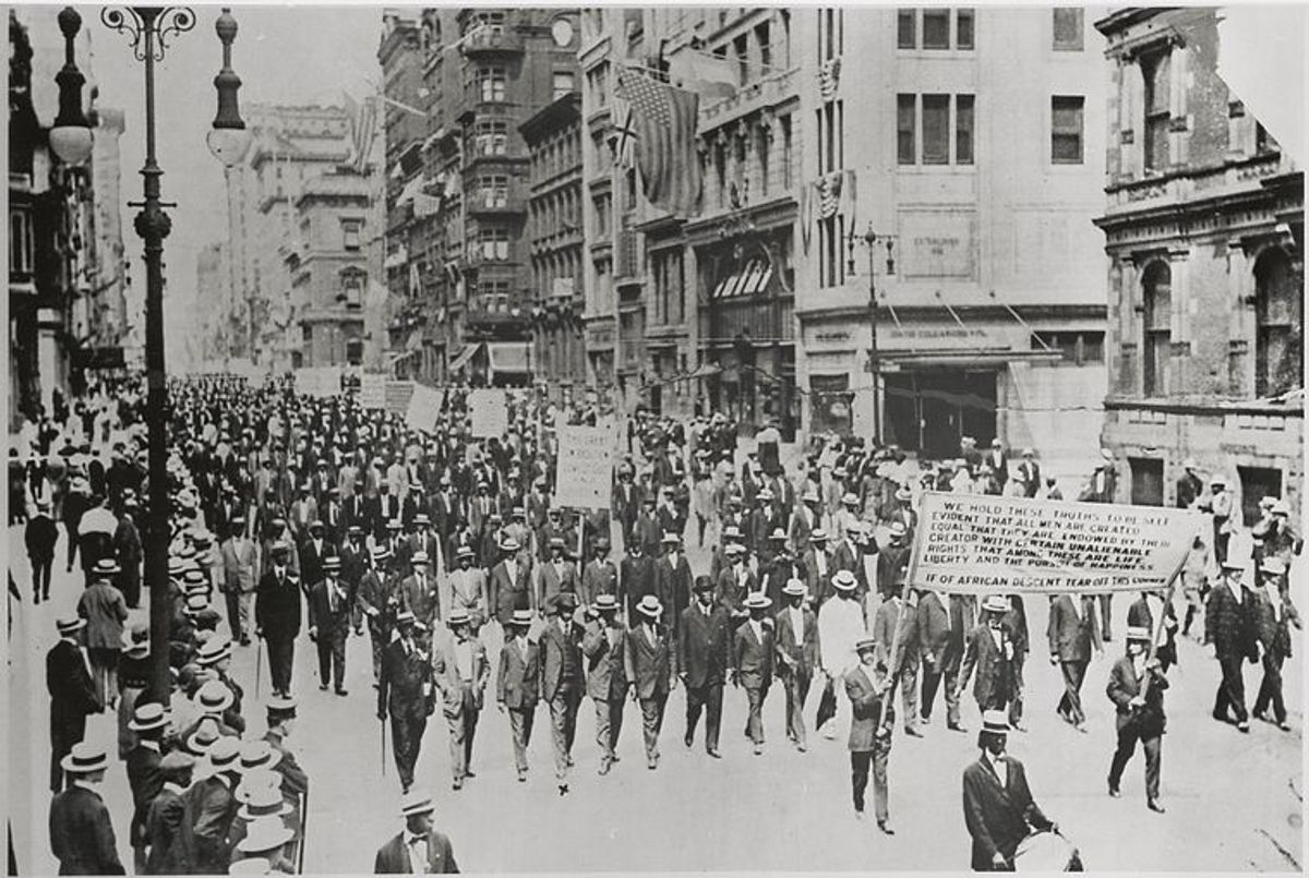 Silent Protest parade on Fifth Avenue, New York City, July 28, 1917, in response to the East St. Louis race riot. In front row are James Weldon Johnson (far right), W. E. B. DuBois (2nd from right), Rev. Hutchens Chew Bishop, rector of St. Philip's Episcopal Church (Harlem) and realtor John E. Nail. (New York Public Library (public domain))